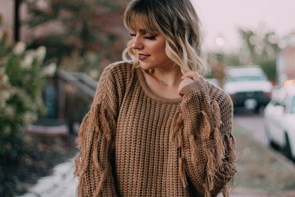 How To Style The Distressed Sweater Trend
