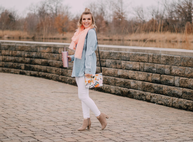 second trimester style photo: blue chambray top, coral scarf, white jeans, and floral bag. Full body shot.