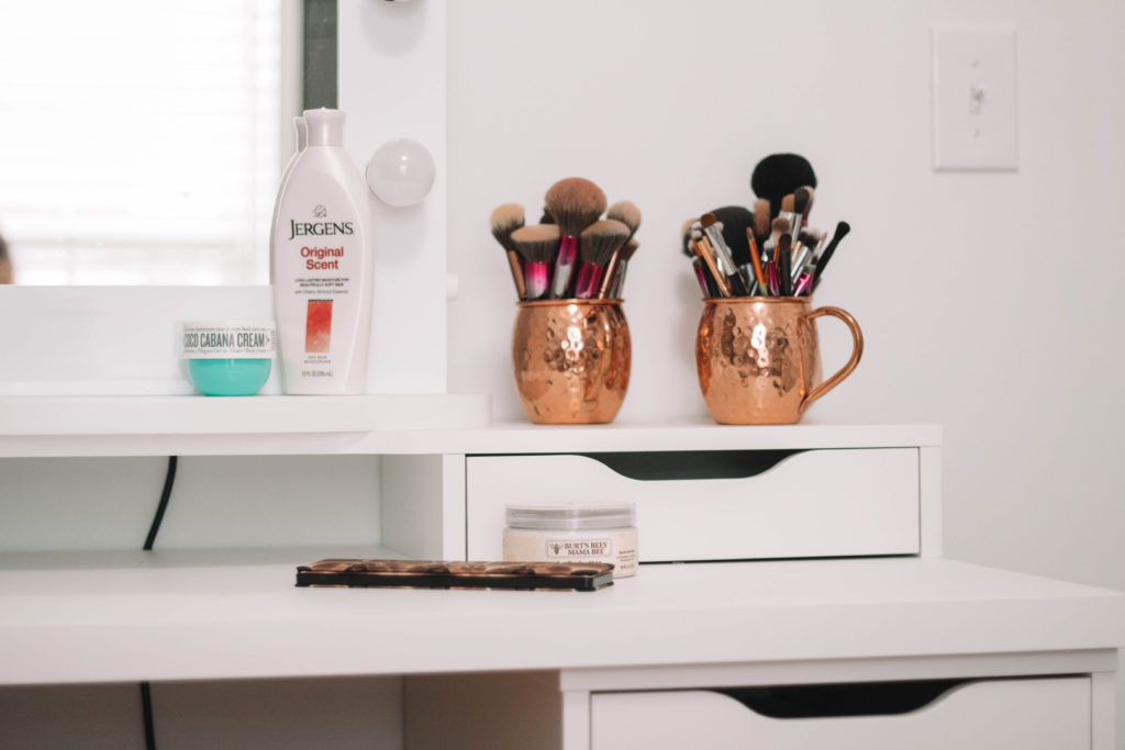 Vanity top with makeup brushes and lotion bottles
