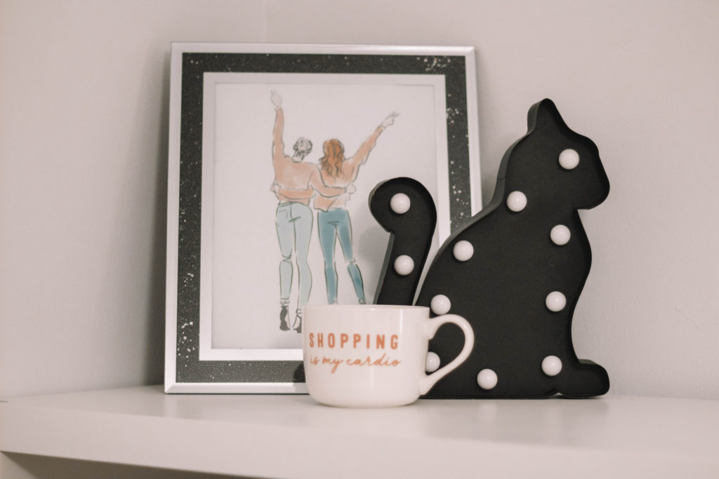 Shelf with mug and picture frame on top.